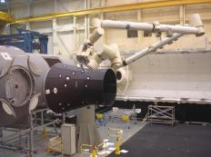 While not in the shape of a traditional hand, the Canadarm, a type of robotic arm, is commonly used in space missions and exploration to move objects.