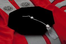 At graduation and academic ceremonies, a PhD student may wear distinctive and elaborate robes and cap.