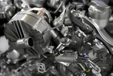 In a typical automobile, the fluid coupling is most commonly called a torque converter.