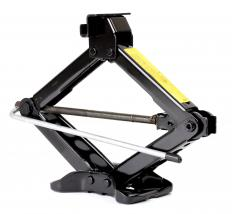 A standard car jack can be used to lift a floor joist during repairs.