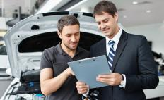 Part of being a skilled car salesman is persuading customers to purchase upgrades and add-ons that they might need.