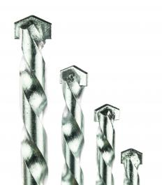 Masonry drill bits can be used in machine drills to bore holes into bricks or concrete.