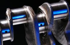 The camshaft is connected by gears or belts to the crankshaft, which allows it to turn in time with the engine.