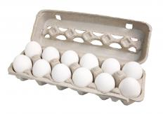 A carton of a dozen eggs. An egg cracker helps crack eggs cleanly.