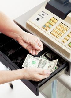 A store manager often is required to count the cash in the register drawer.