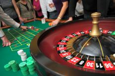 Casino hosts may interact with guests while they play games.