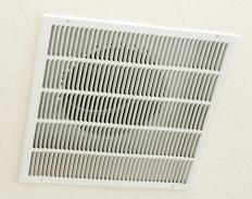 Ceiling air vents like this are common in mechanical ventilation systems.