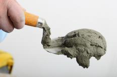 Some kinds of fly ash require a cementing agent, such as quicklime or Portland cement.