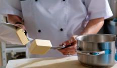 A chef holds a service industry job in the hospitality sector.