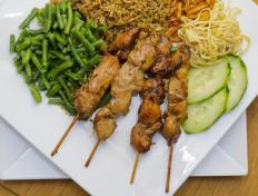 Satay is typically served on skewers.