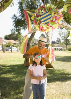 A children's party may feature a piñata that is stuffed with sweet treats, like hard candies and chocolate.