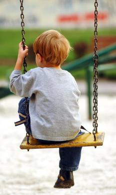 A child on a swingset.