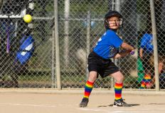 A Little League Coach must be able to teach young children a basic understanding of baseball.
