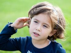 A hearing impaired interpreter may help hearing impaired children learn sign language.