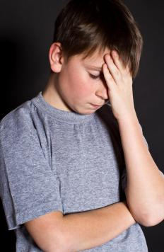 Clonidine may cause headaches in children.