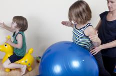 Pediatric physiotherapy may involve the use of a large exercise ball in activities.