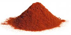 Chili powder is often included in acar.
