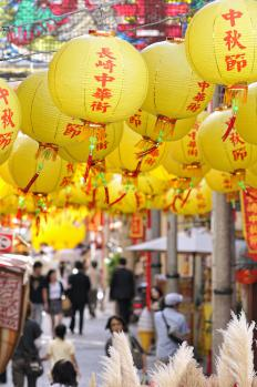 A street decorated with paper lanterns.