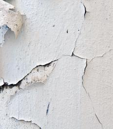 A wall scraper can be used to remove old paint.
