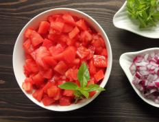 Some recipes for punjene tikvice call for the addition of fresh tomatoes.