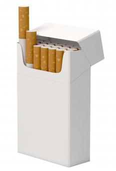 Tobacco use can cause white spots on the gums.