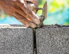 Concrete blocks are often used to build short, load-bearing sleeper walls.