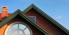 An attic truss is typically used to support a peaked roof.