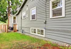 "Boards or planks of cedar cladding are overlapped to create a look often known as ""clapboard"" siding."