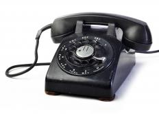 Classic black rotary dial telephone, which contains a rotary switch.
