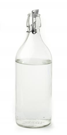 A bottle of vinegar, which can be used to clean aluminum.