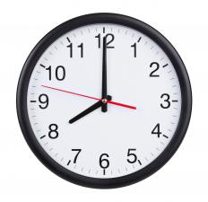 Wall clocks have numbered faces with hour, minute and second hands rather than a digital display.