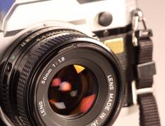 In photography, aperture refers to how much light a lens lets in to create an image on film or electronic sensor.