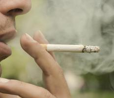 Nicotine from cigarettes may increase lip pigmentation.