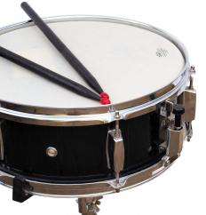Snare drums may be featured in a high school drumline.