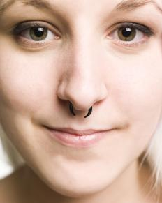 Ornamentation of the nose can be performed by piercing the septum.