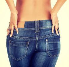Women's jeans tend to fit snugly on the hips and thighs and sit lower on the waist than men's jeans.