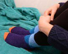 Fleece socks can help conserve body heat in cold weather.