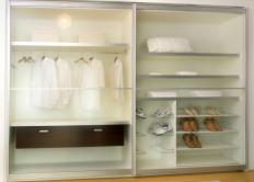 A modular closet may consist of shoe racks, shelves, and hanger bars.