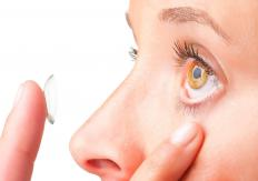 Contact lenses improve vision by refracting incoming light.