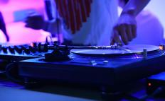 A mobile disc jockey travels to special events with mobile sound systems.