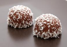 Chocolates covered in coconut flakes.