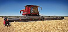 A combine harvester aids in the harvesting of grain crops.