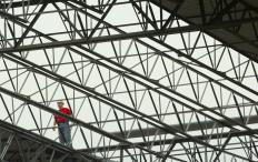 Commercial buildings and warehouses are often built with metal steel rafter frames.