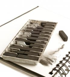 Artists may use compressed charcoal sticks when sketching.