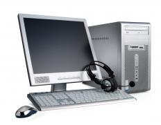 A desktop PC with speech recognition headphones.