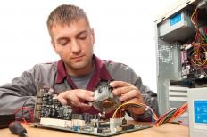 A computer technician working on a computer.