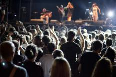 A tour manager is responsible for scheduling a band's concert performances.