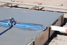 A concrete slab may need to be poured when building a shop.