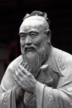 A statue of Confucius, the founder of Confucianism, an Eastern philosophy.