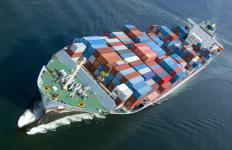 A container forklift is used to load freight containers onto a ship.